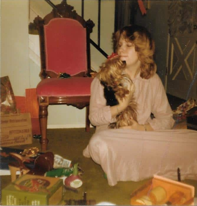 Cathy as a teenager and Ernie the Yorkie